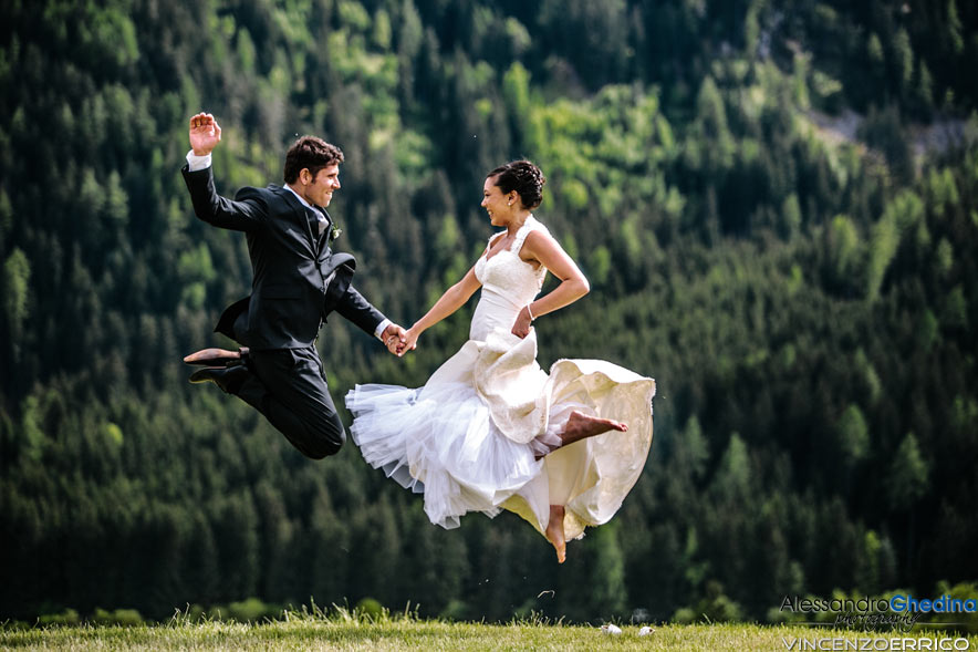wedding couple jumping in the air