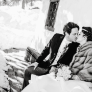 bride and groom kissing - winter wedding
